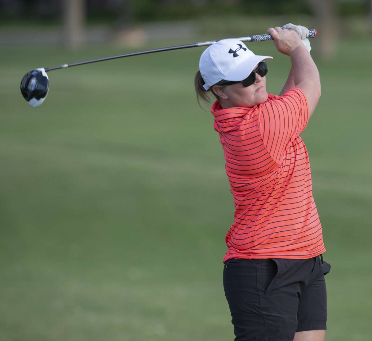 Brooke Schlemeyer follows her shot 07/13/2020 during the qualifying round for the Midland Women's City Golf Tournament at Midland Country Club. Tim Fischer/Reporter-Telegram