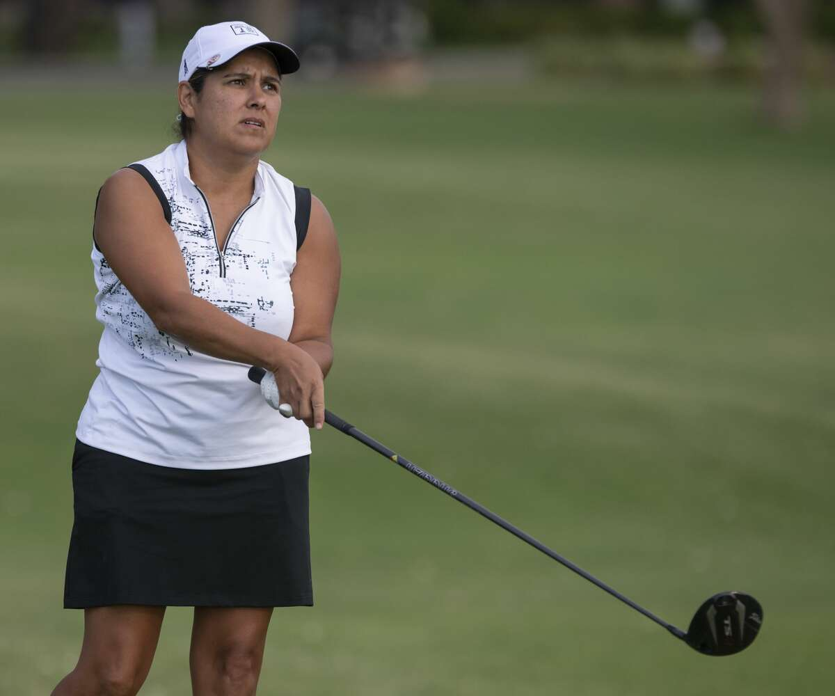 Denise Carbajal follows her shot 07/13/2020 during the qualifying round for the Midland Women's City Golf Tournament at Midland Country Club. Tim Fischer/Reporter-Telegram