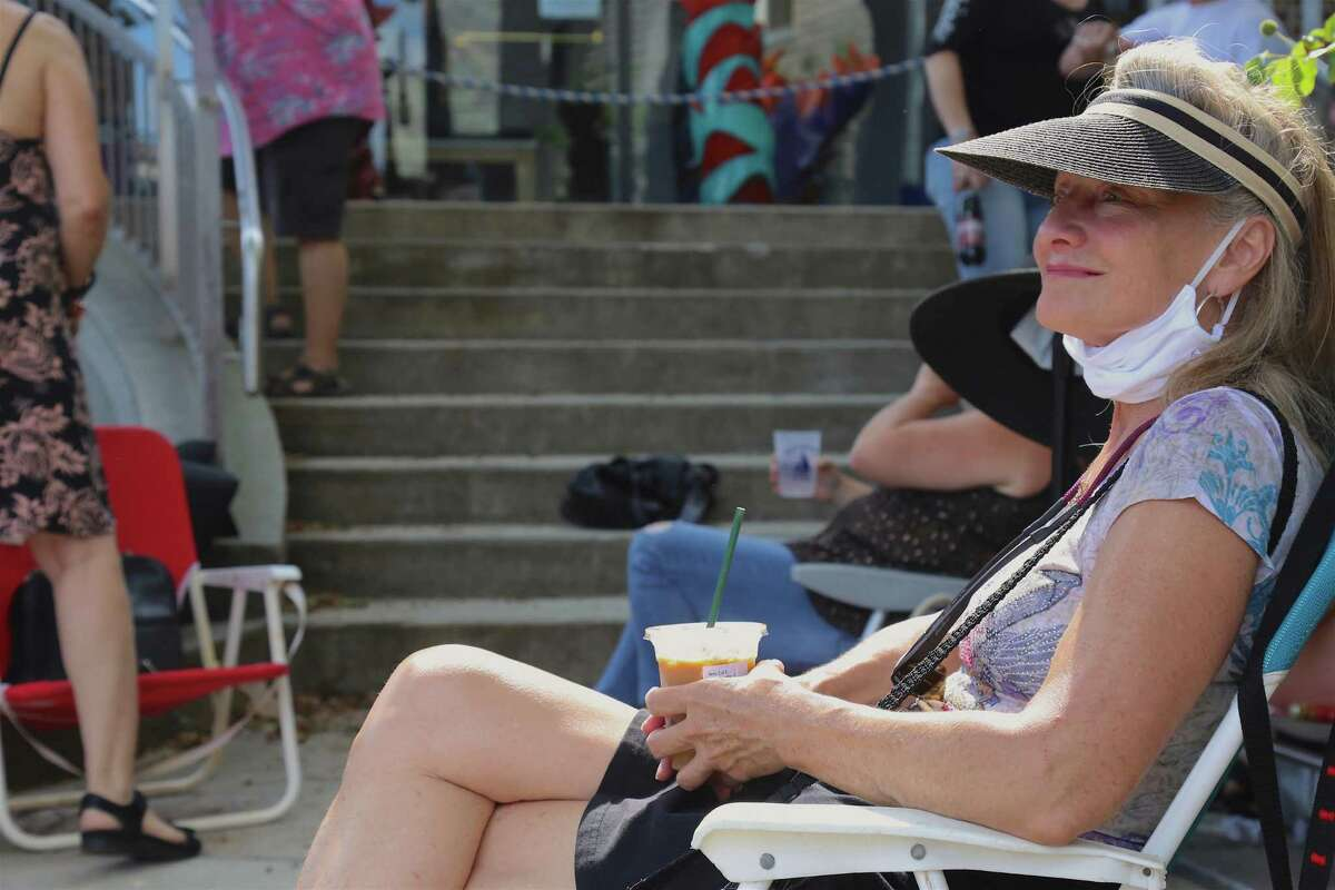 Gloria Dengler of Pawling, N.Y., enjoys some music on Sunday, July 12, 2020, in Westport, Conn.