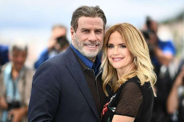 "(FILES) In this file photo taken on May 15, 2018 US actor John Travolta (L) and his wife US actress Kelly Preston pose during a photocall for the film ""Gotti"" at the 71st edition of the Cannes Film Festival in Cannes, southern France. - Kelly Preston, US actress and wife of US actor John Travolta, died after a battle with breast cancer at the age of 57, US media reported on July 12, 2020. (Photo by Anne-Christine POUJOULAT / AFP) (Photo by ANNE-CHRISTINE POUJOULAT/AFP via Getty Images)"