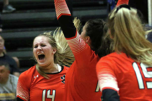 Edwardsville's Maddie Isringhausen celebrates a point in a Tigers victory last season. Edwardsville's Maddie Isringhausen celebrates a point in a Tigers victory last season.