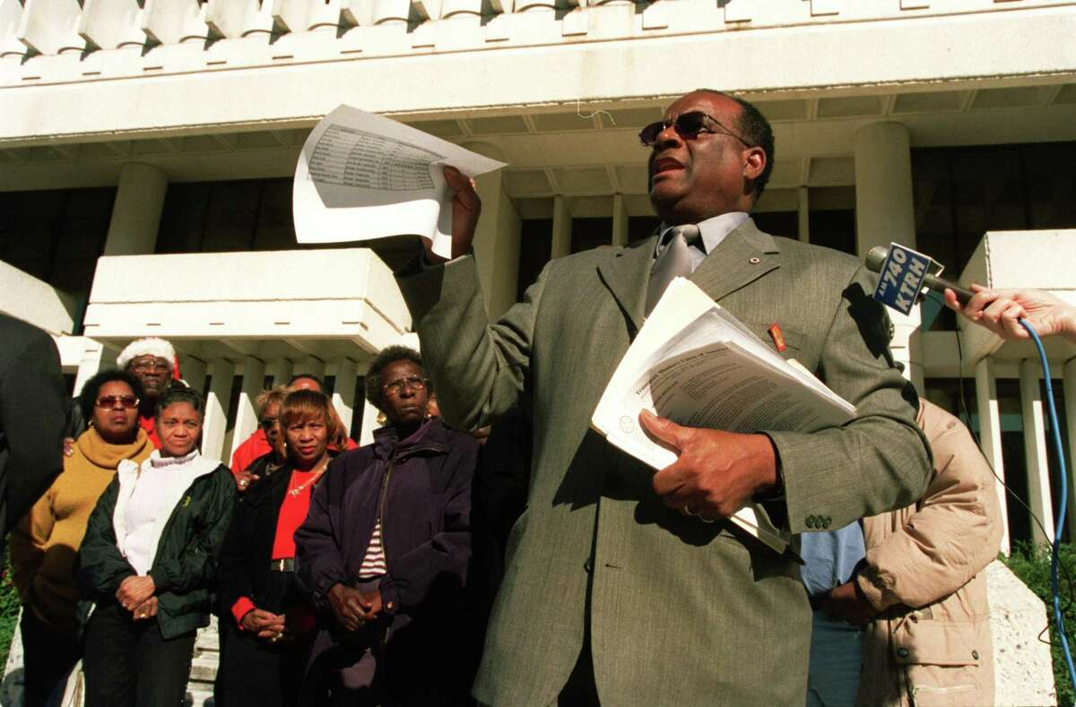 In this file photo from December 2001, John Bland, international representative of the Transport Workers of America, speaks at a press conference in front of HISD headquartersto say HISD bus drivers are working under unsafe and stressful conditions.