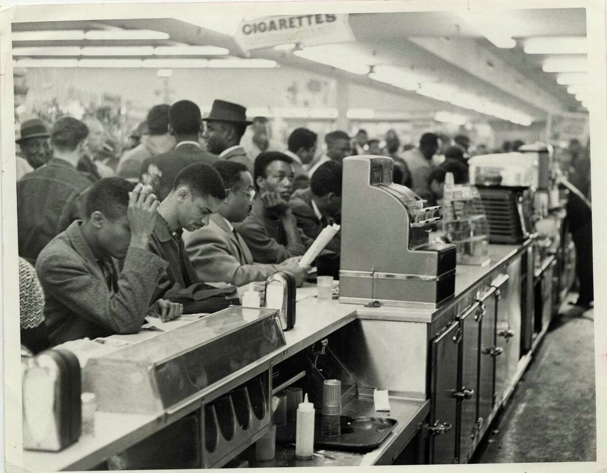 In this file photo from March 1960, student demonstrators, members of the Progressive Youth Association, sit down in protest at a white lunch counter at Weingarten's No. 26, 4110 Almeda. The students, mostly from TSU, occupied all 30 stools at Weingarten's lunch counter. Jim Morgan/© Houston Chronicle