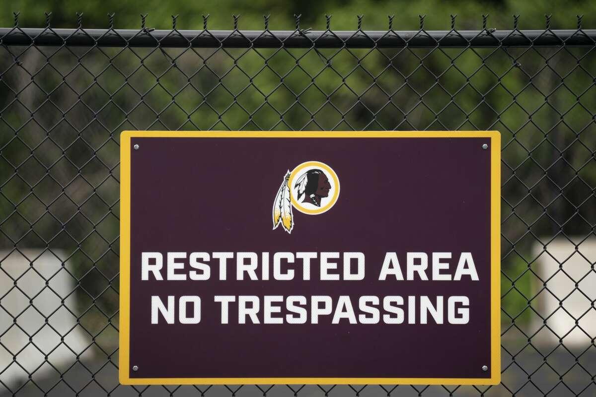 A Washington NFL logo adorns a no trespassing sign at FedEx Field on July 7, 2020 in Landover, Maryland.