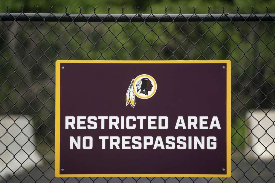A Washington NFL logo adorns a no trespassing sign at FedEx Field on July 7, 2020 in Landover, Maryland. Photo: Drew Angerer/Getty Images / 2020 Getty Images