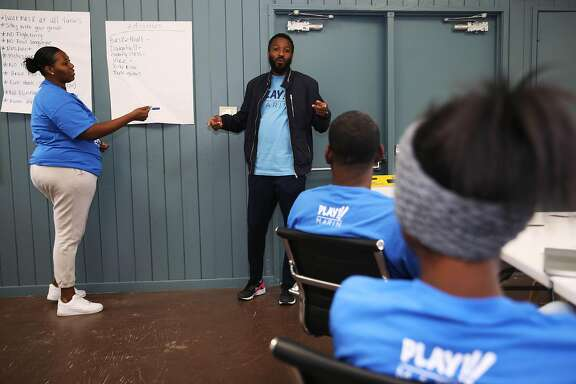 (From left to right): Tashay Coleman, 30 and, Paul Austin converse during a Play Marin staff meeting at the Marin City Recreation Center, located at 630 Drake Ave., on Wednesday, July 1, 2020, in Sausalito, Calif. Austin leads the nonprofit, Play Marin, that runs sports leagues and other classes for youth in Marin City. Most of the kids in these programs live in public housing. Paul grew up in Marin City and has been pushing for county executives to provide more funding to programs and infrastructure in Marin City. He's been pointing out the large disparities between Marin City's resources and the surrounding wealth of Sausalito and the rest of Marin County