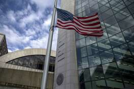 An American flag flies outside the headquarters building of the Securities and Exchange Commission in Washington, D.C., on Dec. 22, 2018.