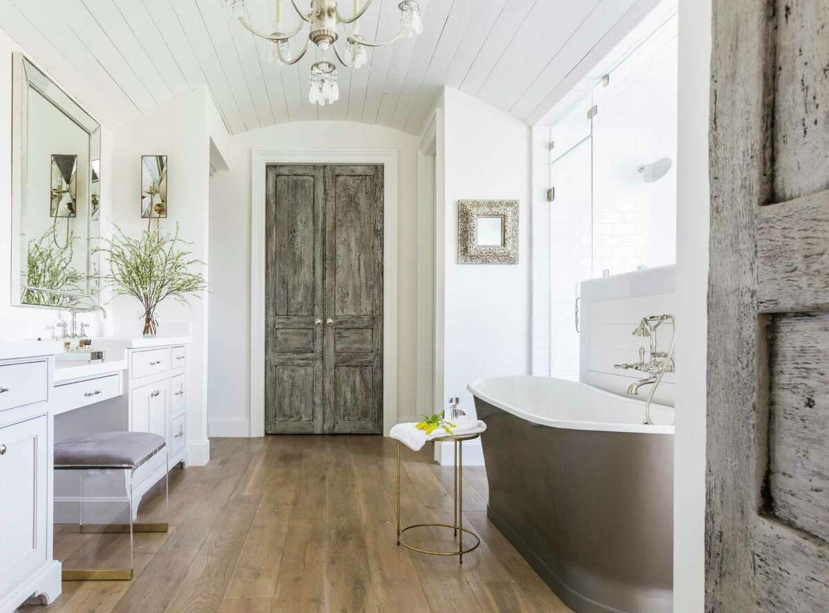 1. New floor plan: Sometimes you walk into a room and wonder why it was organized that way. Marie Flanigan Interiors redesigned this League City primary bathroom to take advantage of wasted space for a much larger shower. Glamour was added with this free-standing bathtub.