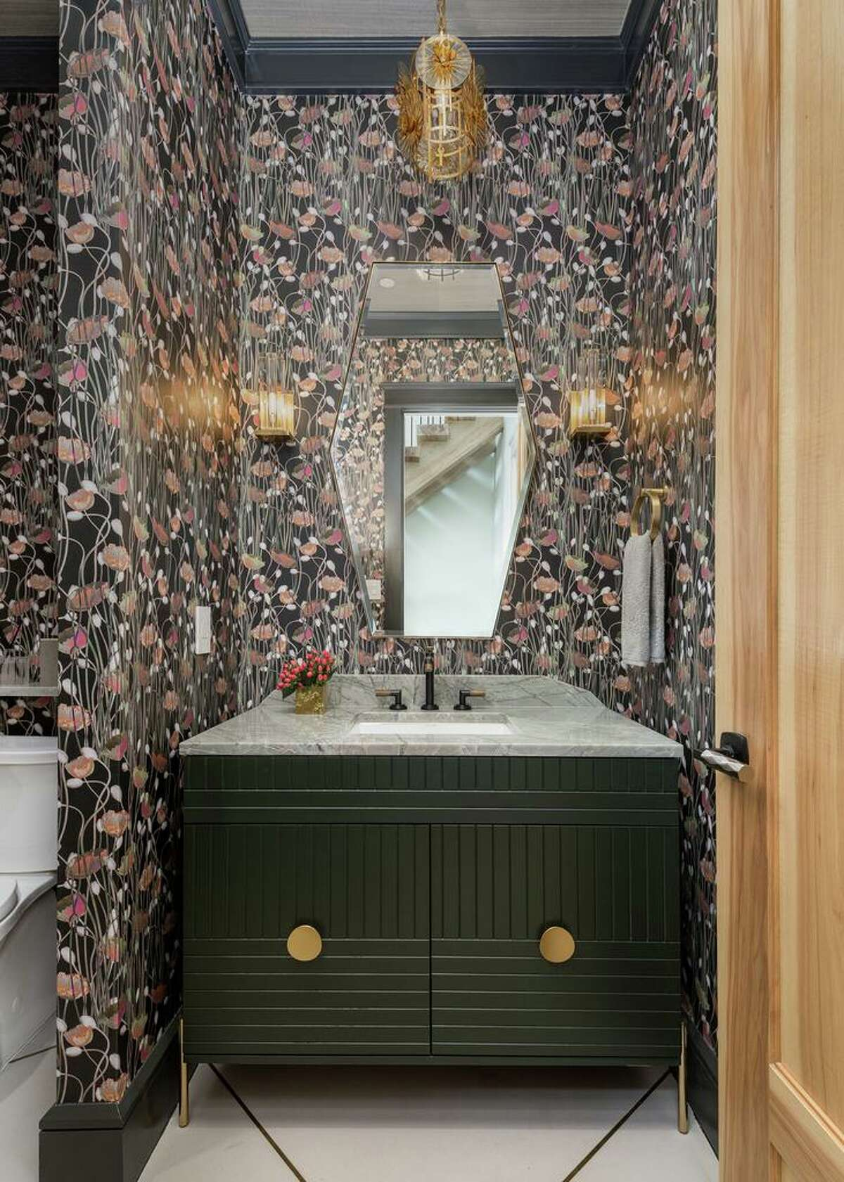 3. The details: Getting a bathroom right isn't about any one thing - it's about getting all of the details right. In her own powder bathroom interior designer Laura Manchee (Laura Manchee Designs) coordinated bold wallpaper with beautiful lighting, great hardware and visually interesting flooring.