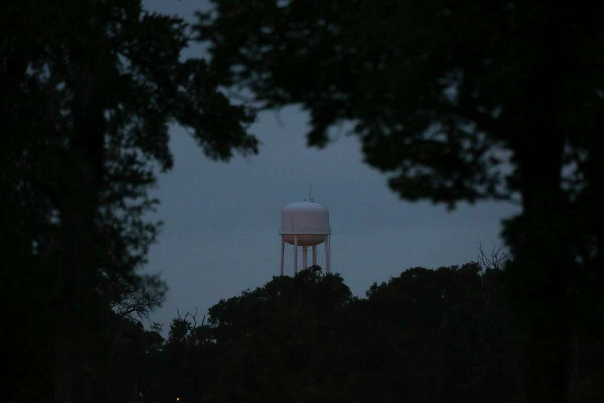 The Wallace Pack Unit water tower is seen through foliage Wednesday, Aug. 9, 2017, in Navasota. ( Yi-Chin Lee / Houston Chronicle )
