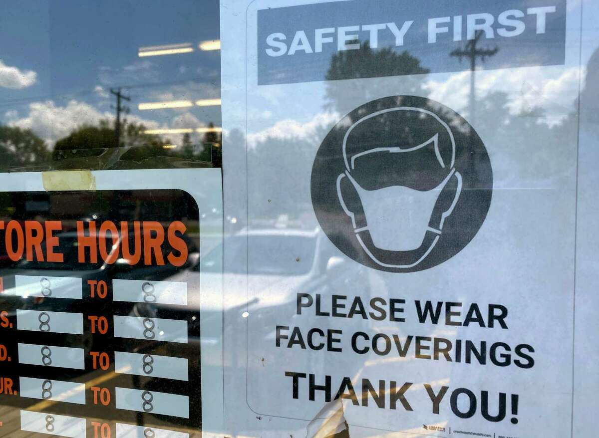 Signs urging customers to wear masks are posted on the front door of a True Value Hardware store on Monday, July 13, 2020, in Bethlehem, N.Y. (Will Waldron/Times Union)