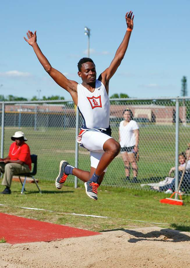 """Joshua Anadu of Seven Lakes jumps 44' 11.5"""" in the first round of the 6A Men's Triple Jump event at the UIL Area Track Meet held at Seven Lakes High School on April 22, 2015. Photo: Diana L. Porter, Freelance / For The Chronicle / © Diana L. Porter"""