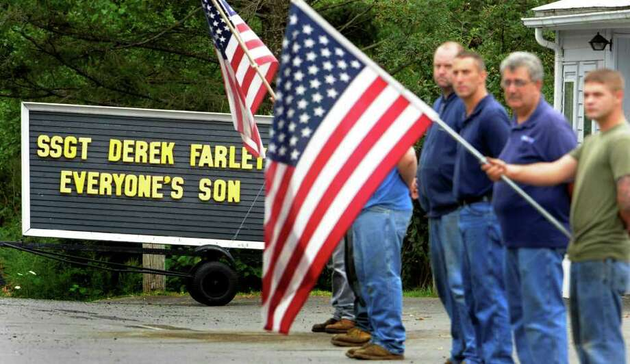 Mourners wait on the side of the road at Thoma Tire Company  for the casket carrying the remains of Staff Sgt. Derek Farley in Schodack on August 25, 2010.   (Skip Dickstein/Times Union) Photo: Skip Dickstein