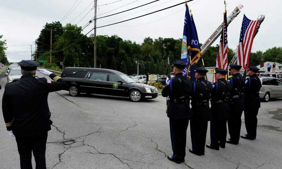 The hearse carrying the casket of Staff Sgt. Derek Farley enters Lyons Funeral Home on Washington Avenue Extension in Rensselaer on August 25, 2010.   (Skip Dickstein/Times Union) Photo: Skip Dickstein / 2008