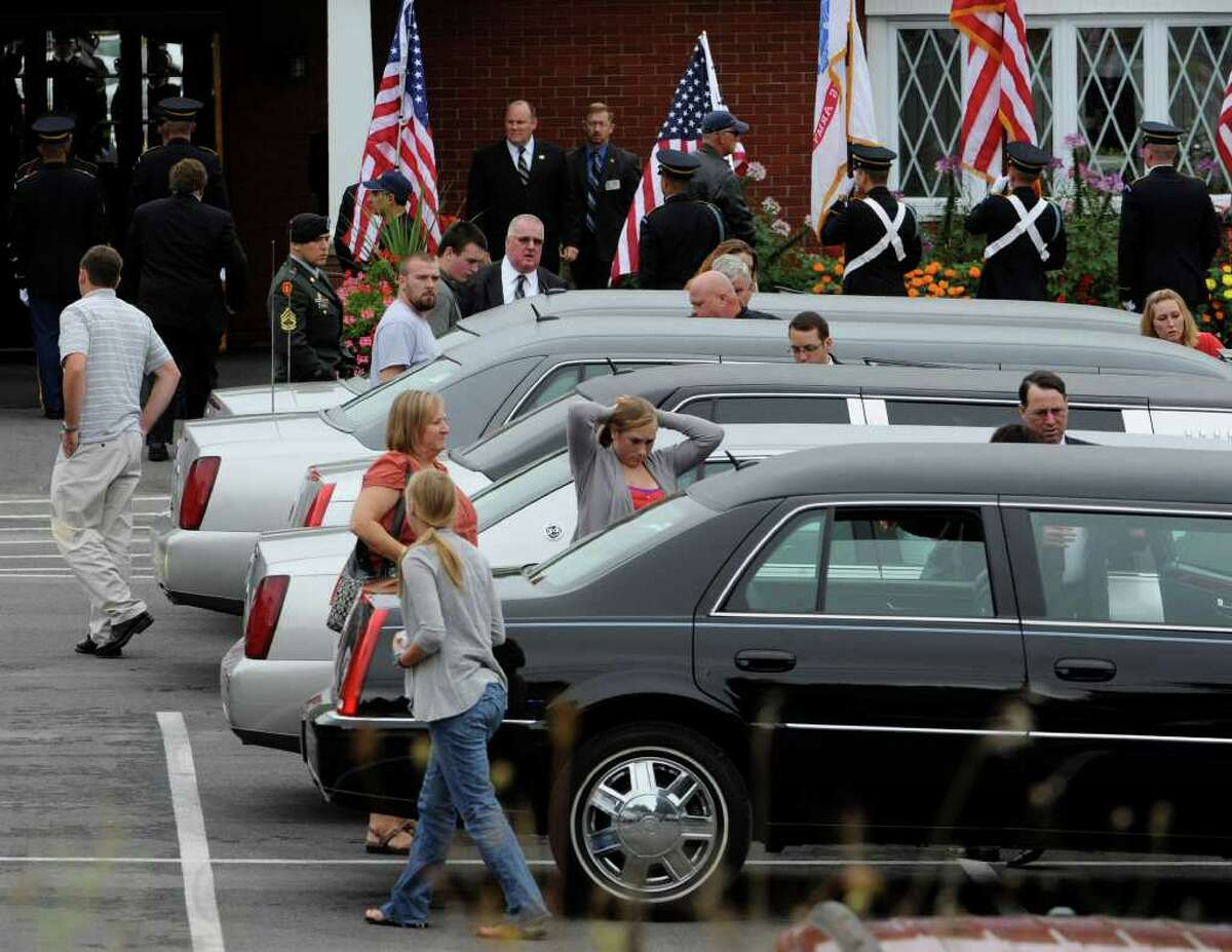 Mourners enter the Lyons Funeral Home on Washington Avenue Extension in Rensselaer on August 25, 2010. (Skip Dickstein/Times Union)