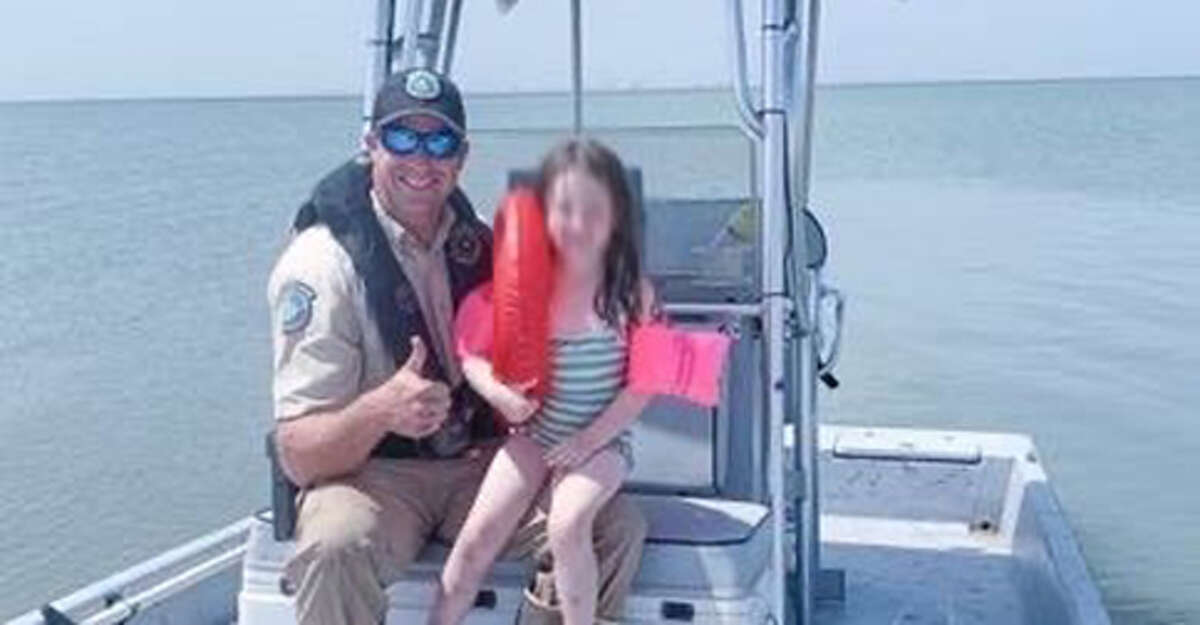 Texas game warden Ben Bailey rescued a child who had been swept from shore in Lavaca Bay last week.