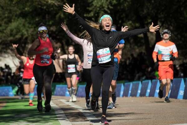 Claudia Olivares celebrates as she runs down the final stretch toward the finish line of the Chevron Houston Marathon Sunday, Jan. 19, 2020 in Houston.