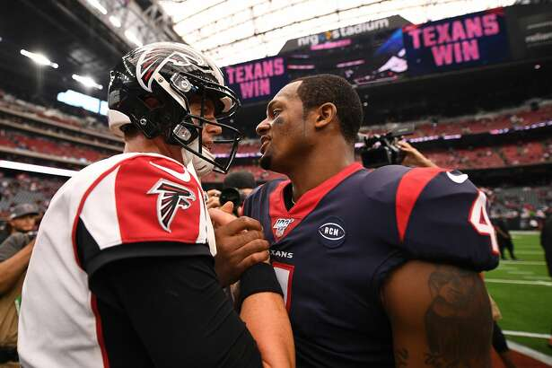 HOUSTON, TEXAS - OCTOBER 06: Matt Ryan #2 of the Atlanta Falcons and Deshaun Watson #4 of the Houston Texans meet after the game at NRG Stadium on October 06, 2019 in Houston, Texas. (Photo by Mark Brown/Getty Images)