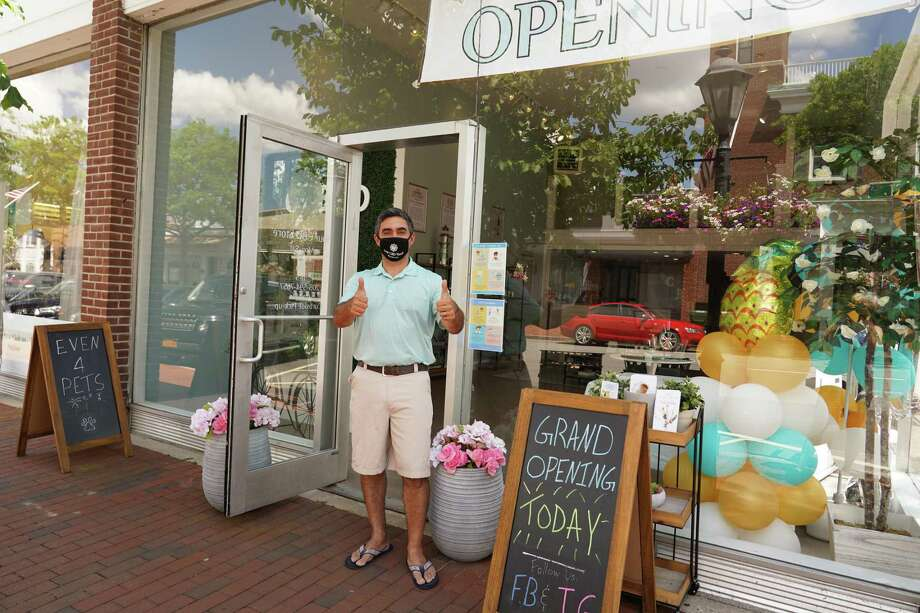Owner Anthony Pisano gives the thumbs up in New Canaan on one of the days of his three day grand opening over the weekend for his Your CBD Store location at 48 Elm Street on Sunday, July 12, 2020. Oversized balloons, a large grand opening banner, and a sandwich sign announced the opening of the store, an unusual sight during the coronavirus pandemic. The grand opening started Friday, July 10, 2020, and went through Sunday. Photo: Grace Duffield / Hearst Connecticut Media