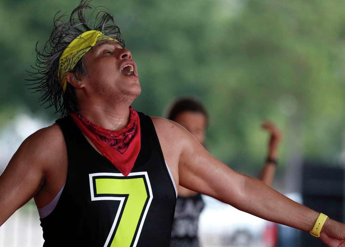 Rafael Rios sweats as he lead his outdoor Zumba class at Langham Creek Family YMCA, Saturday, July 11, 2020, in Houston.