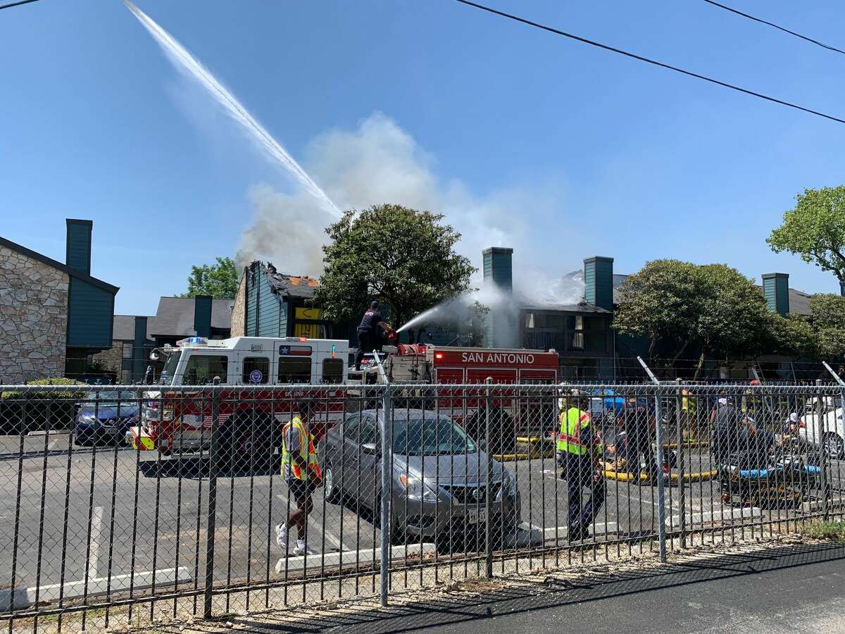Firefighters are battling a blaze at a North Side apartment complex Monday afternoon.