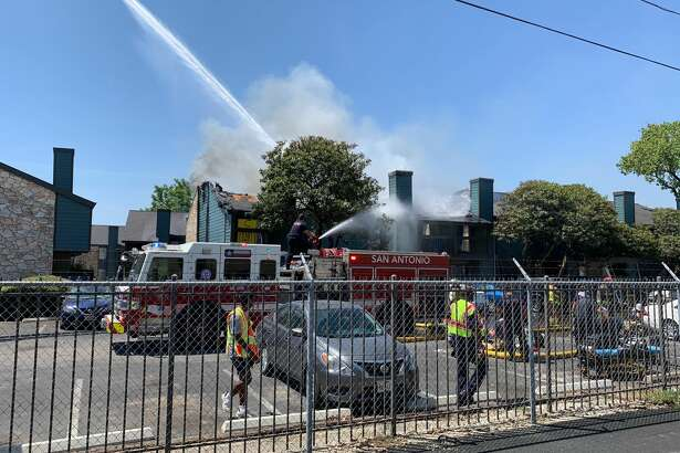 Firefighters are battling a blaze at a North Side apartment complex Monday afternoon. Firefighters are battling a blaze at a North Side apartment complex Monday afternoon.