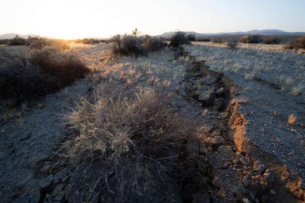 Surface ruptures and offsets caused by yesterday's magnitude 7.1 earthquake are seen as the sun sets along State Route 178 between Ridgecrest and Trona California on June 6, 2019. - Local residents and out of town visitors flocked to the spot to see the earthquake's geologic effects on the earth's surface. (Photo by Robyn Beck / AFP) (Photo credit should read ROBYN BECK/AFP via Getty Images)