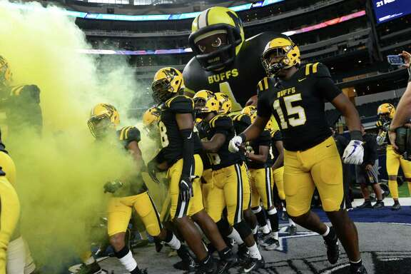 The Ft. Bend Marshall Buffalos take the field for the Class 5A Div. II Texas State Championship game against the Aledo Bearcats at AT&T Stadium in Arlington, TX on Saturday, December 21, 2019.
