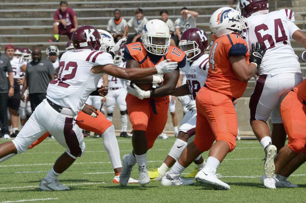 Nelvens Borgella (17) of Bush carries the ball on a touchdown run during the first quarter of a 6A Region III District 20 football game between the Bush Broncos and Kempner Cougars on Saturday, October 5, 2019 at Mercer Stadium, Sugar Land, TX.