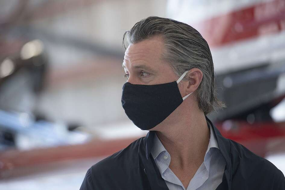 California Gov. Gavin Newsom visits the California Department of Forestry and Fire Protection's McClellan Reload Base in Sacramento, Calif., Thursday, July 9, 2020, to discuss the state's new efforts to protect emergency personnel and evacuees from COVID-19 during wildfires. (AP Photo/Hector Amezcua, Pool)