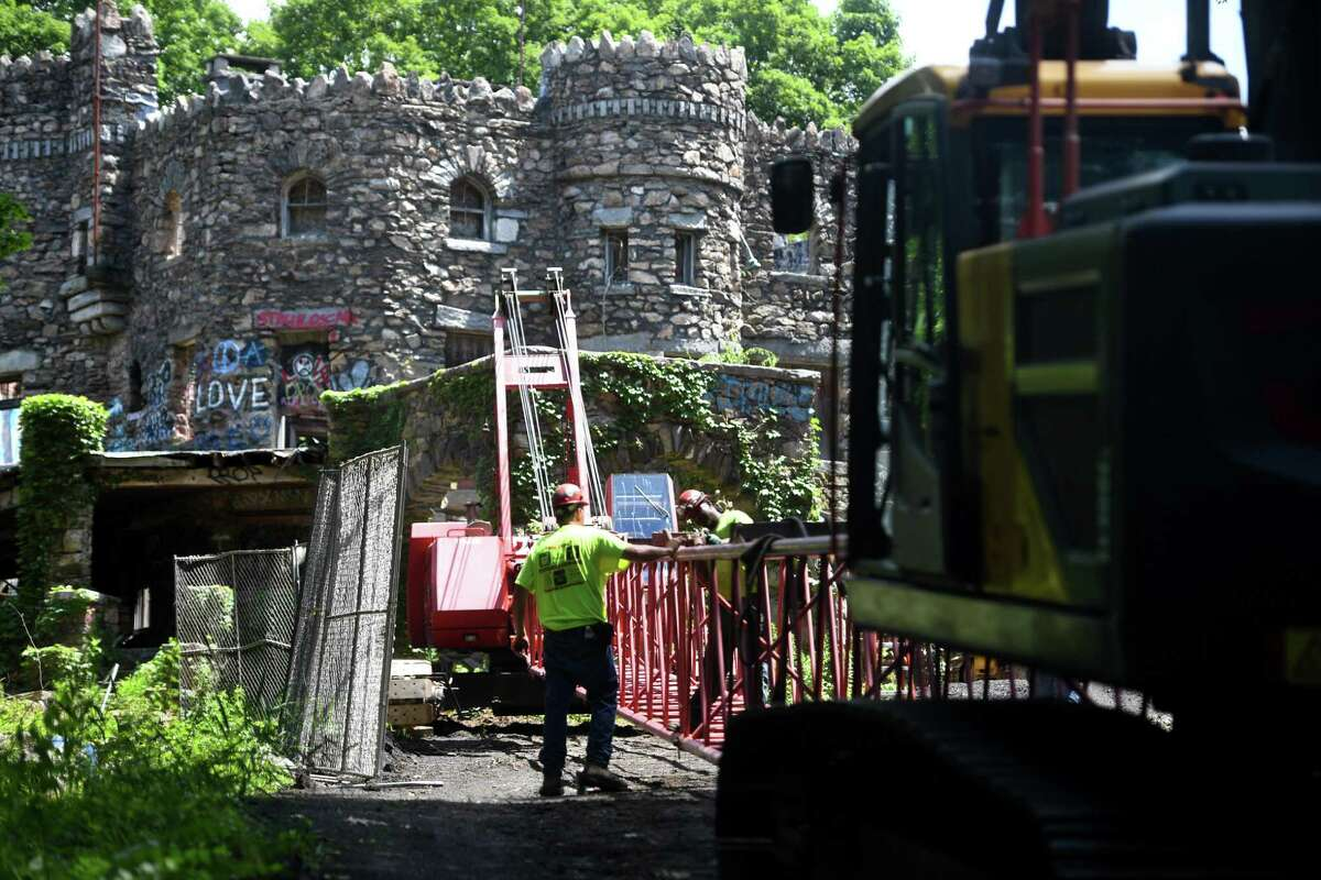 Work begins on abatement of the Hearthstone Castle historic site on Brushy Hill Road in Danbury, Conn. on Monday, July 13, 2020.
