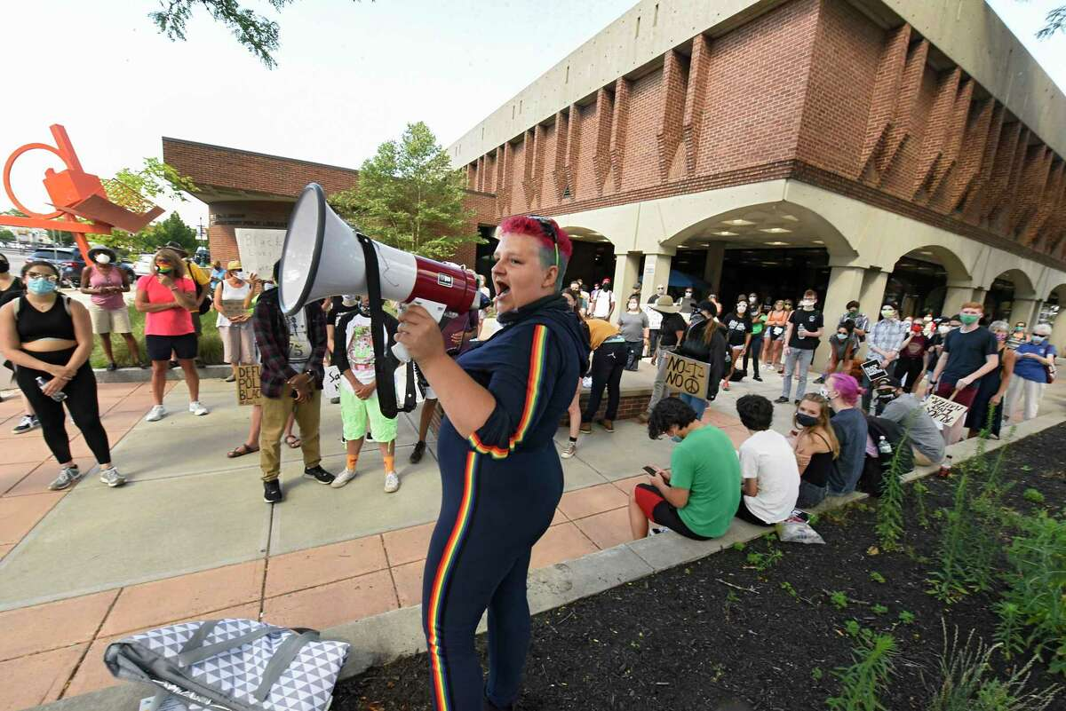 Sabrina Chambers of Schenectady uses a megaphone as Black Lives Matter demonstrators protest the treatment of Yugeshwar Gaindarpersaud outside of Schenectady library on Monday, July 13, 2020 in Schenectady, N.Y. Gaindarpersaud who was arrested last Monday in a videotaped confrontation showed a police officer putting his knee on Gaindarpersaud's neck. (Lori Van Buren/Times Union)
