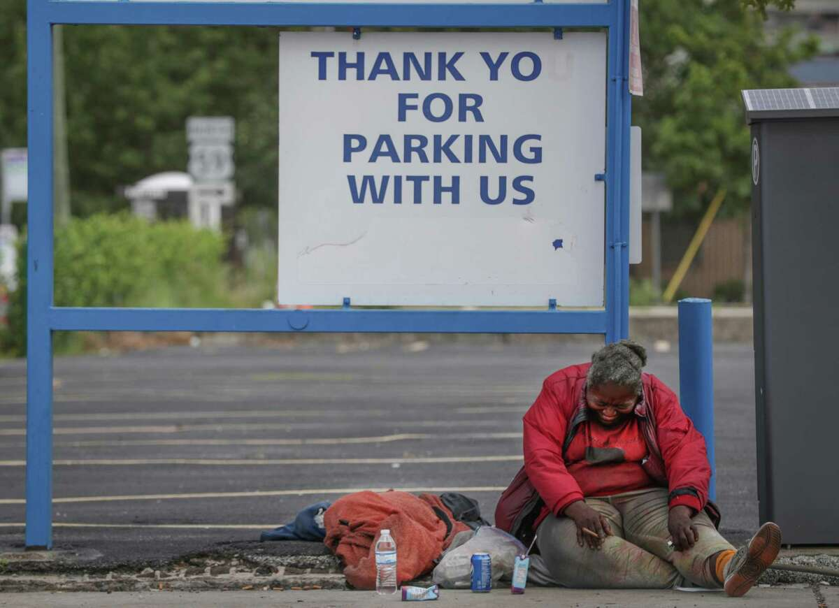 A homeless woman looks distressed near Minute Maid Park Tuesday, June 30, 2020, in Houston.
