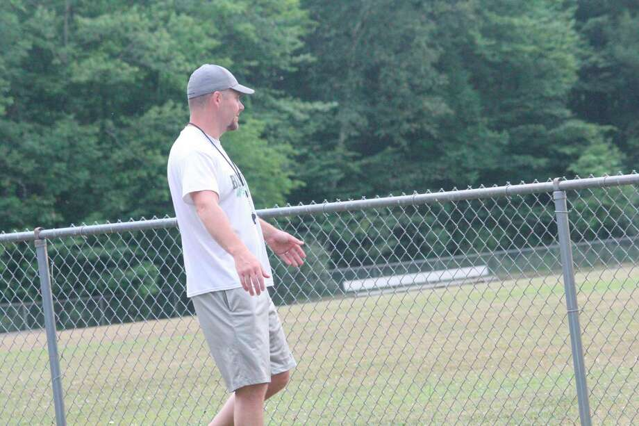 Pine River football coach Terry Martin supervises a conditioning session at his practice field last week. (Pioneer photo/John Raffel)