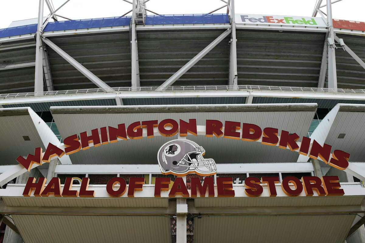 Signs for the Washington Redskins are displayed outside FedEx Field in Landover, Md., Monday, July 13, 2020. The Washington NFL franchise announced Monday that it will drop the a€œRedskinsa€ name and Indian head logo immediately, bowing to decades of criticism that they are offensive to Native Americans. (AP Photo/Susan Walsh)