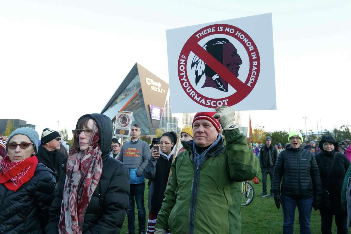 FILE - In this Oct. 24, 2019, file photo, Native American leaders protest against the Redskins team name outside U.S. Bank Stadium before an NFL football game between the Minnesota Vikings and the Washington Redskins in Minneapolis. A new name must still be selected for the Washington Redskins football team, one of the oldest and most storied teams in the National Football League, and it was unclear how soon that will happen. But for now, arguably the most polarizing name in North American professional sports is gone at a time of reckoning over racial injustice, iconography and racism in the U.S. (AP Photo/Bruce Kluckhohn, File)