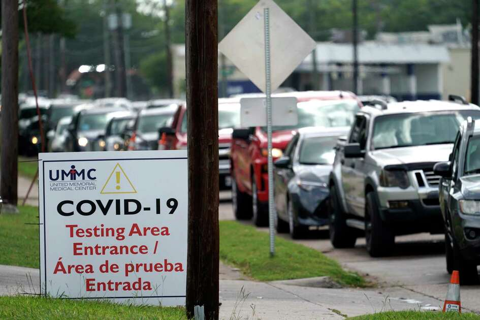 People wait inside their vehicles in line at a COVID-19 testing site Wednesday, July 8, 2020, in Houston. Texas has surpassed 10,000 new coronavirus cases in a single day for the first time as a resurgence of the outbreak rages across the U.S. The record high of 10,028 confirmed cases Tuesday follows Republican Gov. Greg Abbott decision to mandate masks in much of the state and to close bars, retreating from what had been one of America's fastest reopenings. (AP Photo/David J. Phillip)