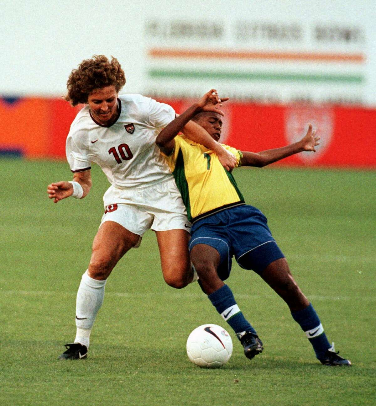 FILE -- United States midfielder Michelle Akers,(10), battles for the ball as Brazil's Maycon during their friendly match in Orlando, Fla. Saturday, May 22, 1999. The United States won 3-0. Akers, the grande dame of American soccer, has low blood pressure and chronic fatigue syndrome. And she's not sure how much she can play in the Women's World Cup.