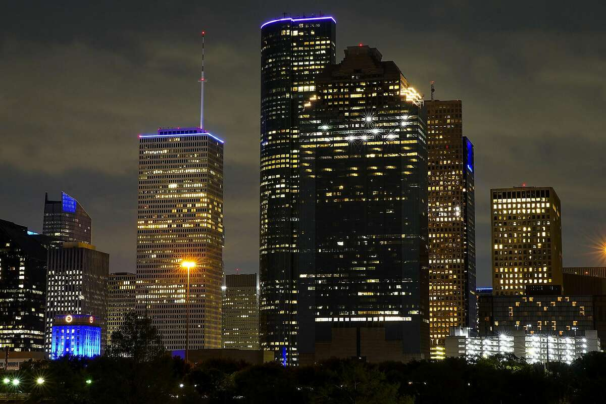 Some buildings in Houston's skyline are lit blue for part of a nationwide #LightItBlue movement to honor essential workers on the front lines of the coronavirus pandemic on Thursday, April 9, 2020.