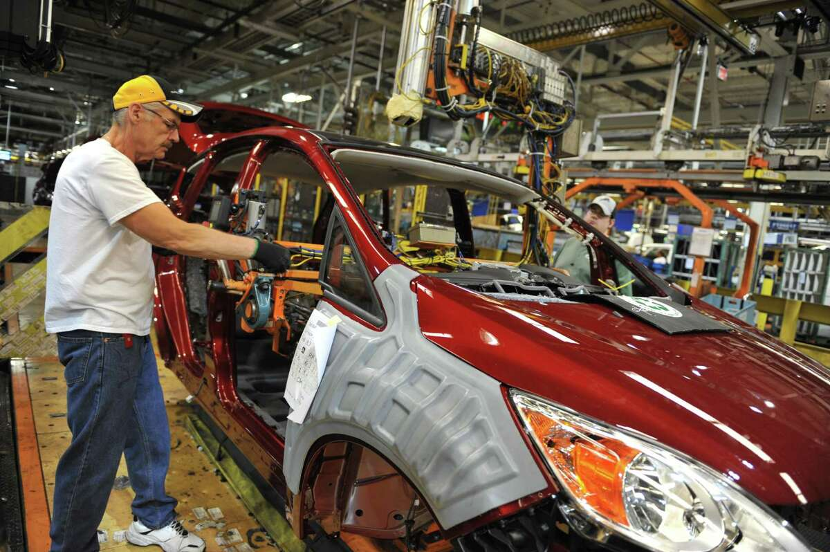 (FILES)An auto worker installs the dashboard on a Focus at Ford's Michigan Assembly Plant in this October 1, 2013, file photo taken in Wayne, Michigan. Ford will add 350 jobs and invest $150 million at a US stamping plant as part of a major expansion of its capacity, the automaker said November 21, 2013. The investment will be used to upgrade equipment at its Buffalo, New York facility and the new jobs will support a third shift of production. Ford said it is more than three-fourths of the way to its goal of creating 12,000 hourly jobs in the United States by 2015. AFP PHOTO/MIRA OBERMAN / FILESMIRA OBERMAN/AFP/Getty Images ORG XMIT: Ford to a