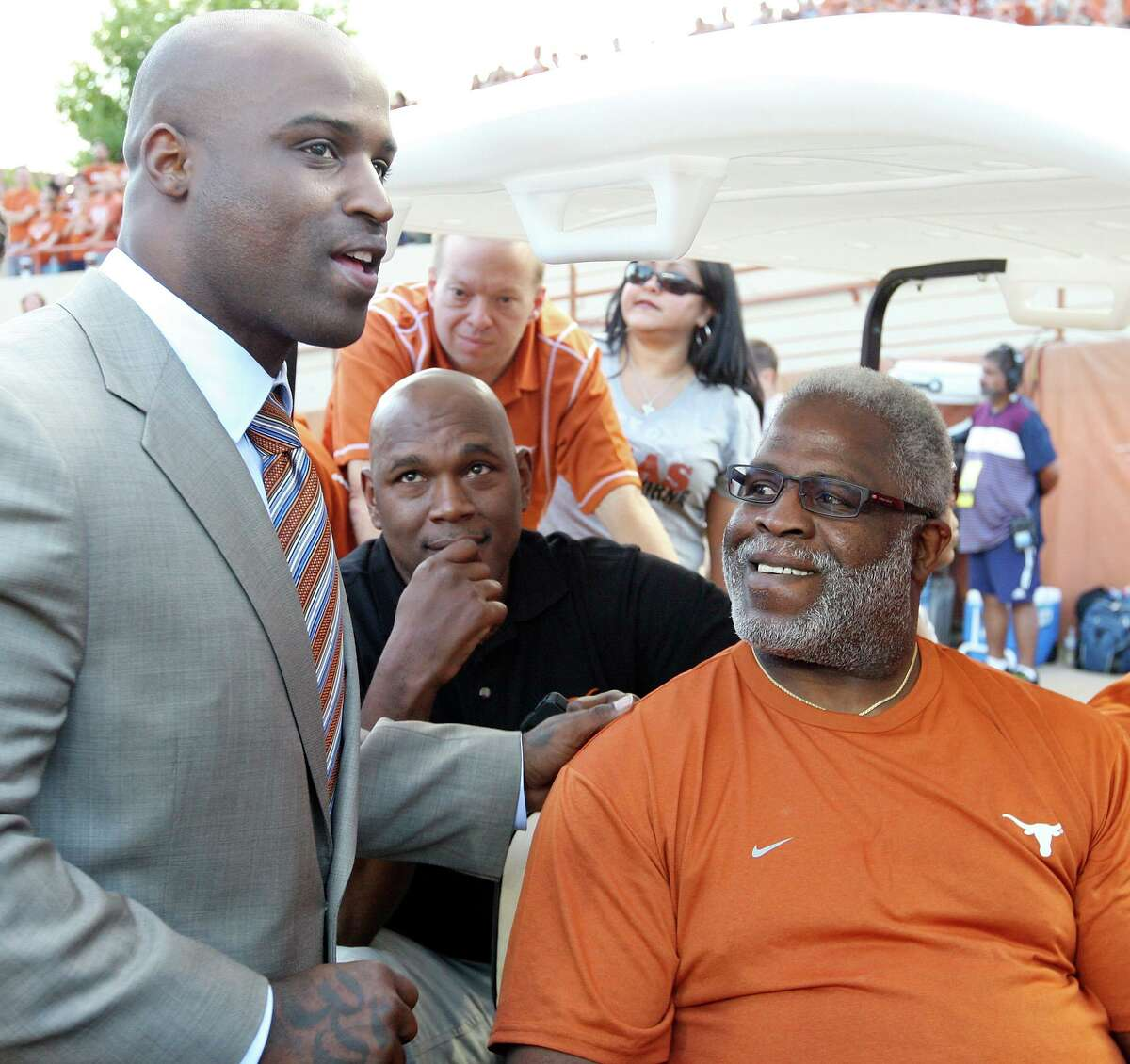 Former Texas Longhorns players Ricky Williams (left) and Earl Campbell talk before the Texas Longhorns-New Mexico Lobos game Saturday Sept. 8, 2012 at Texas Memorial Stadium in Austin, Texas. UT announced on July 13, 2020 that it will rename Joe Jamail Field after the pair of Heisman Trophy winners.