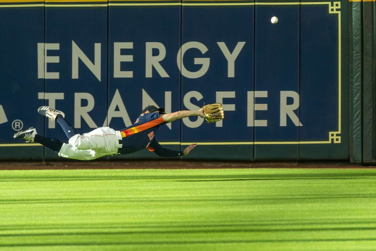 Houston Astros outfielder Chas McCormick dives for a fly ball during a simulated game, part of the team's summer camp workout, Monday, July 13, 2020, at Minute Maid Park in Houston.