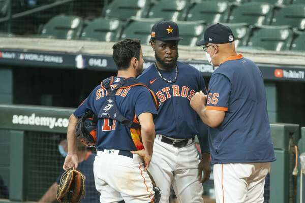 Houston Astros pitcher Cristian Javier and Houston Astros catcher Garrett Stubbs speak with Houston Astros pitching coach Brent Strom between innings during a simulated game, part of the team's summer camp workout, Monday, July 13, 2020, at Minute Maid Park in Houston.