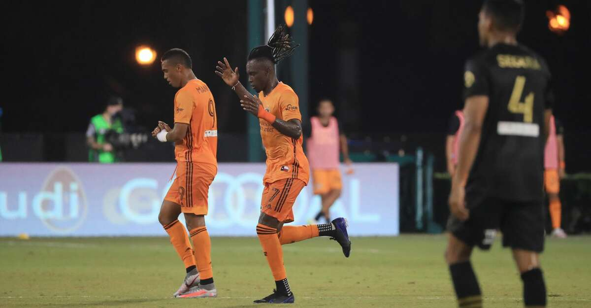 Alberth Elis #7 of Houston Dynamo celebrates the third goal of his team during a match against Los Angeles FC as part of MLS is Back Tournament at ESPN Wide World of Sports Complex on July 13, 2020 in Reunion, Florida. (Photo by Mike Ehrmann/Getty Images)