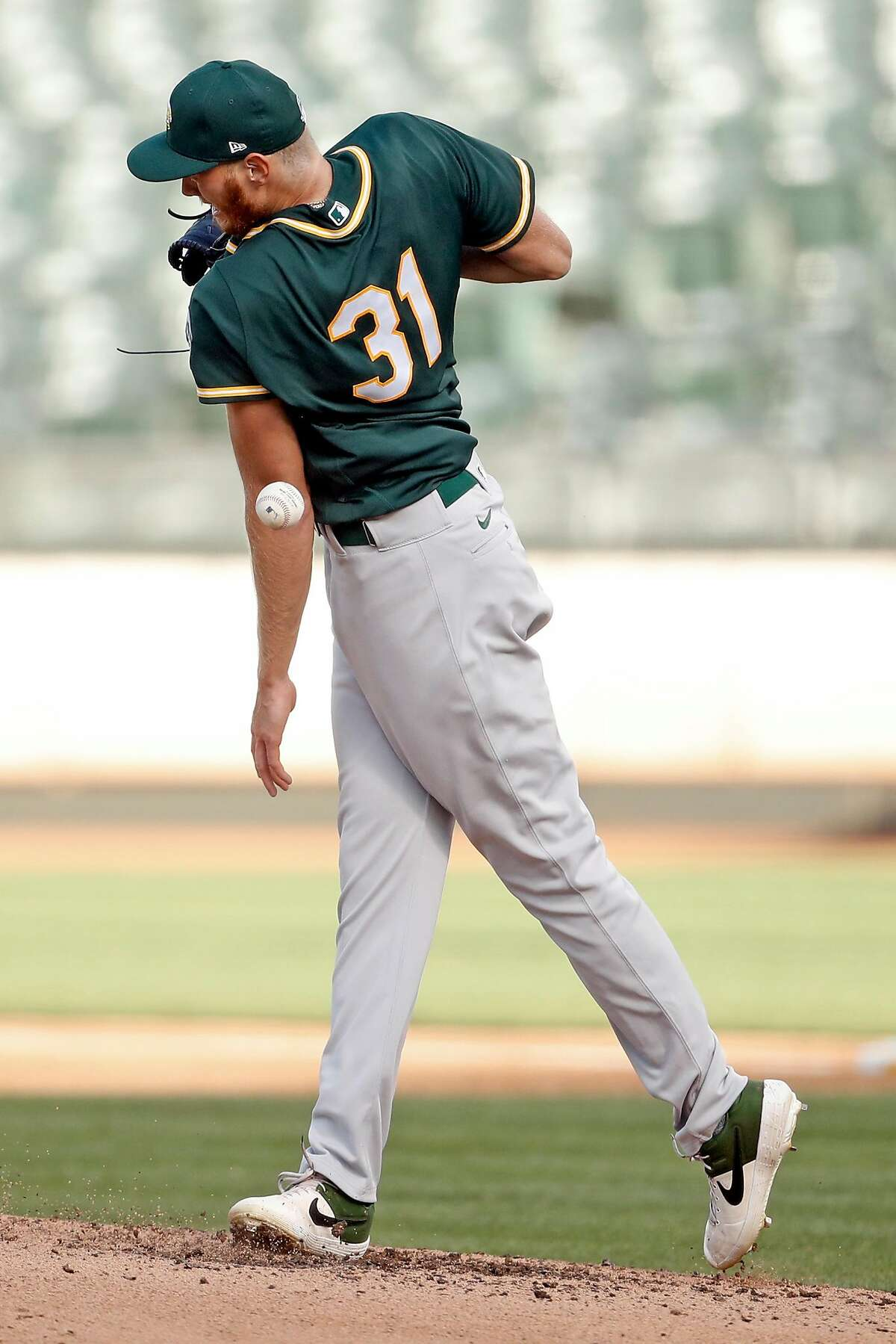 Oakland Athletics' pitcher A.J. Puk gets hit in the arm by a grounder off the bat of Robbie Grossman during intrasquad simulated game at Oakland Coliseum in Oakland, Calif., on Monday, July 13, 2020.Puk is on pace to join the A's as a reliever next week, general manager David Forst said on a conference call Thursday.