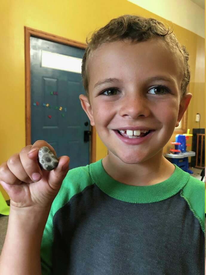 Levi Isanhart found his first Petoskey stone on Friday in his family's driveway in Coleman. (Photo provided)
