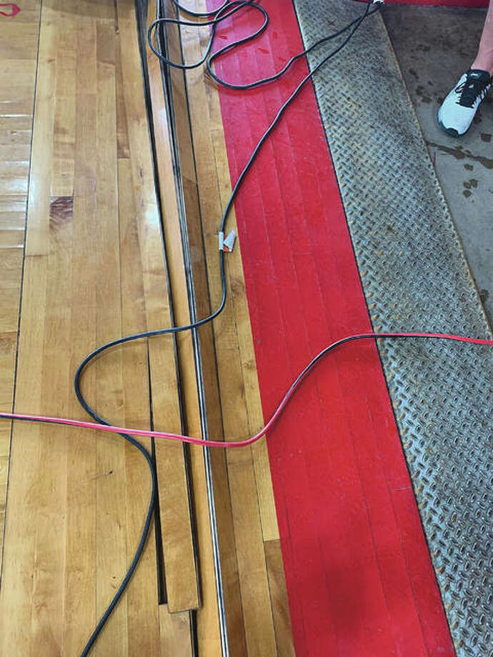 The wood floor of the JHS Bowl sustained water damage and likely needs to be replaced. Jacksonville School District 117 is considering giving community members a chance to buy pieces of the old floor. Photo: Photo Courtesy Of Steve Ptacek