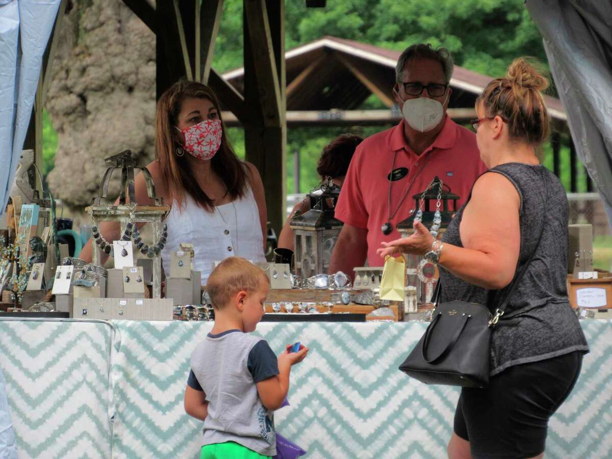 Shoppers talk with a vendor about the wares at the Great Lakes Market's Summer Market on Saturday, July 11, 2020. (Victoria Ritter/vritter@mdn.net)