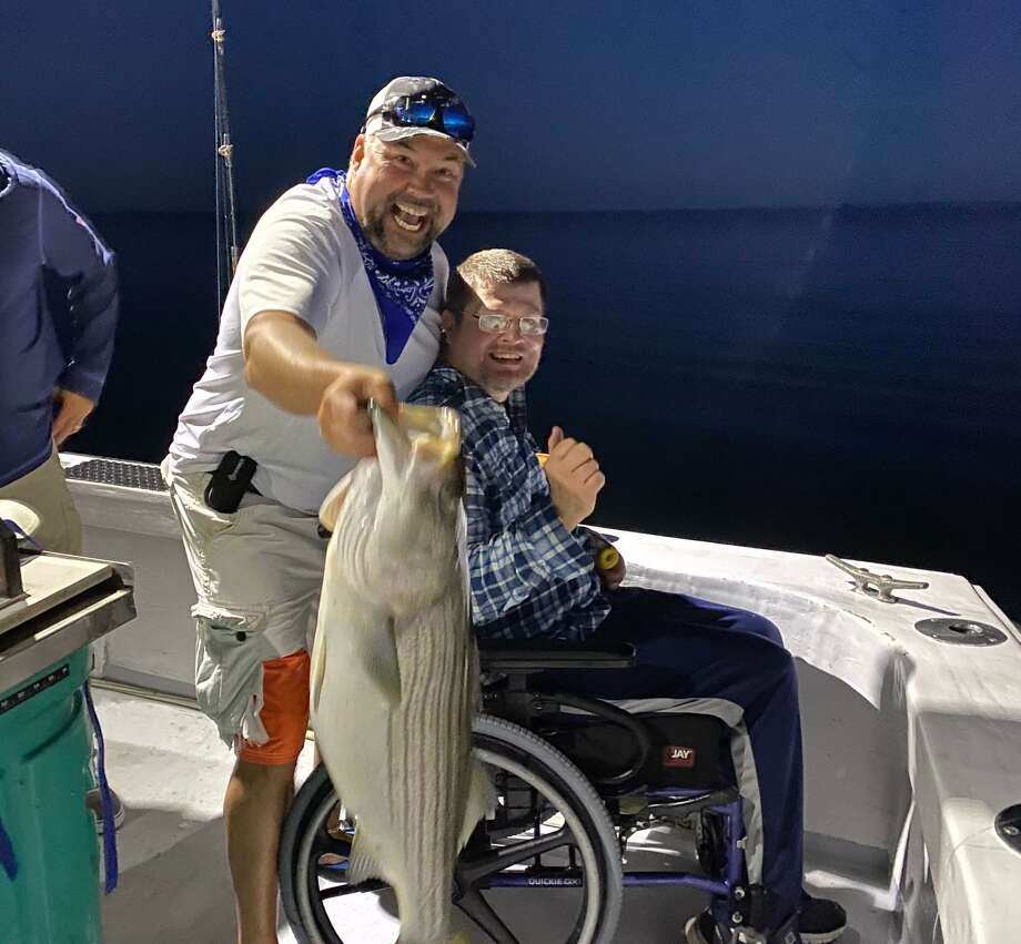 Dan Beyer, left, and Mark Smolen show off their latest catch on a recent fishing excursion. Photo: Contributed Photo / Connecticut Post