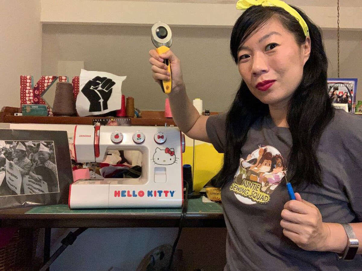 Comedian Kristina Wong, who started the Auntie Sewing Squad, at work sewing masks in her Los Angeles apartment.